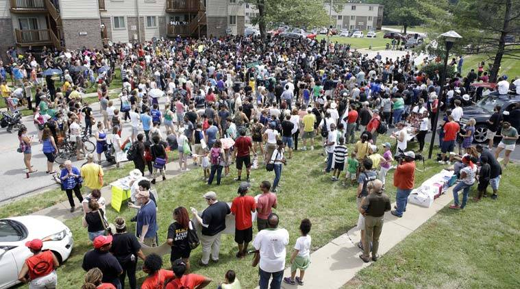 Several hundred people gather for a remembrance for Michael Brown. AP