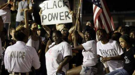 Protesters take to Ferguson streets to mark anniversary of Michael Brown killing