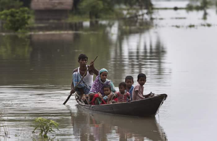 Floods in Assam, Floods in Guwahati, Floods in Kaziranga, Floods in Morigaon, Assam Floods, Indian monsoon Floods, India Floods, Monsoon Floods, Heavy Rainfall, Heavy rains, Heavy rains in Assam, Assam Floods Information, Assam Floods rescue operation, Assam Floods News, Floods News, India Floods News