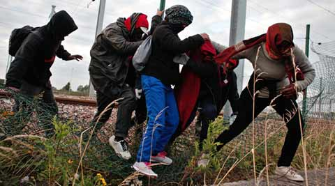 UK, France say ending Calais migrant crisis is 'top priority'