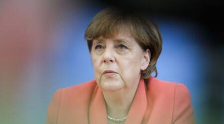 Angela Merkel, Germany india relation, stable predictable tax regime, retrospective taxation, Indian express, business news