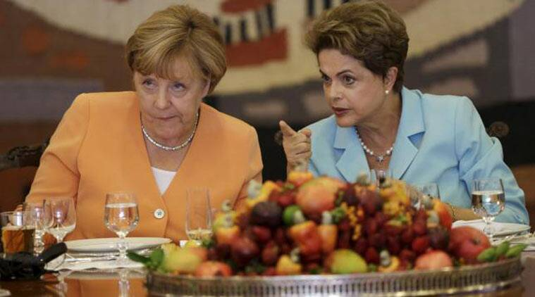Germany's Chancellor Angela Merkel (L) listens to Brazil's President Dilma Rousseff during a lunch at the Itamaraty Palace in Brasilia, Brazil, August 20, 2015. (Source: Reuters photo)