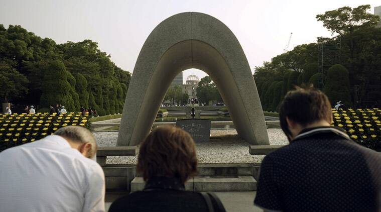 Visitors pray for the atomic bomb victims at the Hiroshima Peace Memorial Park in Hiroshima, western Japan Thursday, Aug. 6, 2015. Japan marked the 70th anniversary of the atomic bombing on Hiroshima. (AP Photo/Koji Ueda)