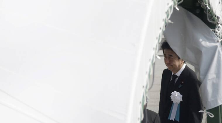 Japanese Prime Minister Shinzo Abe walks out from the venue after the ceremony to mark the 70th anniversary of the bombing at the Hiroshima Peace Memorial Park in Hiroshima, western Japan Thursday, Aug. 6, 2015. (AP Photo/Eugene Hoshiko)