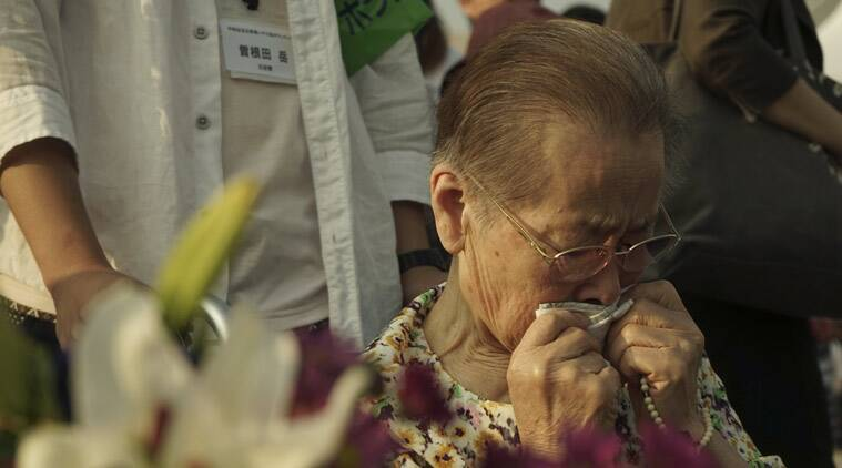 A woman grieves in front of the cenotaph at the Hiroshima Peace Memorial Park in Hiroshima, western Japan, early Thursday, Aug. 6, 2015. Japan marked the 70th anniversary of the atomic bombing on Hiroshima. (AP Photo/Koji Ueda)