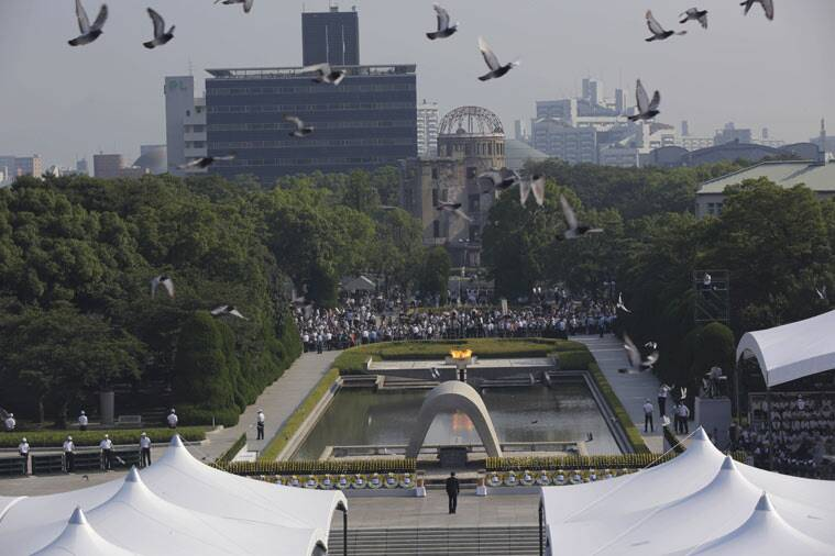 Doves fly over the cenotaph dedicated to the victims of the atomic bombing at the Hiroshima Peace Memorial Park during the ceremony to mark the 70th anniversary of the bombing in Hiroshima, western Japan Thursday, Aug. 6, 2015. (AP Photo/Eugene Hoshiko)