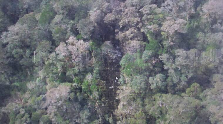This photo released by the National Search and Rescue Agency (BASARNAS) of Indonesia Monday, Aug. 17,2015 shows the part of the wreckage that BASARNAS identified as of the missing Trigana Air Service flight that crashed in Oksibil, Papua, Indonesia. Smoldering wreckage of the passenger turboprop plane with 54 people on board was spotted from the air Monday morning in a rugged area of the easternmost province of Papua, rescue officials said. (AP Photo/The National Search and Rescue Agency of Indonesia)