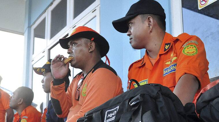 Members of the National Search and Rescue Agency (BASARNAS) wait before leaving on a search for the missing Trigana Air Service flight at Sentani airport in Jayapura, Papua province, Indonesia, Monday, Aug. 17, 2015. (Source: AP)