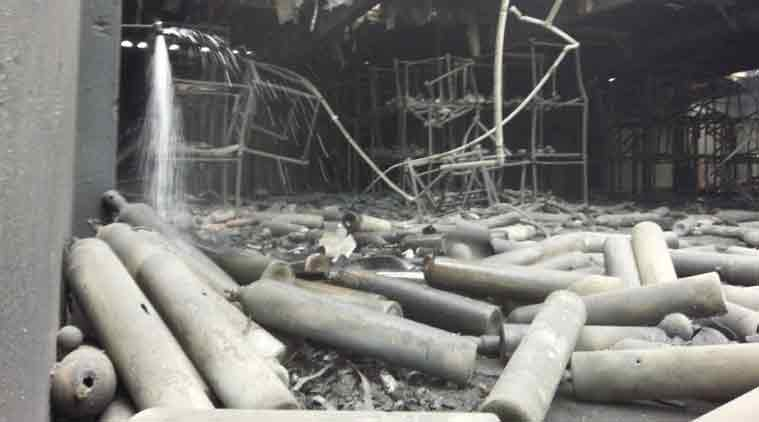 In this image provided by the U.S. Army, the roof is partially collapsed as canisters of compressed gases including nitrogen, oxygen, Freon, and air are strewn about in one-story concrete building after an explosion at the U.S. Army Sagami Depot in Sagamihara, about 25 miles (40 kilometers) southwest of Tokyo, Monday, Aug. 24, 2015. (Source: AP)
