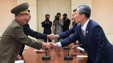 South Korean presidential security adviser Kim Kwan-jin, right, and Unification Minister Hong Yong-pyo, second right, shake hands with Hwang Pyong So, left, North Korea' top political officer for the Korean People's Army, and Kim Yang Gon, a senior North Korean official responsible for South Korean affairs, during after their meeting at the border village of Panmunjom in Paju, South Korea, Tuesday, Aug. 25, 2015. (Source: AP photo)