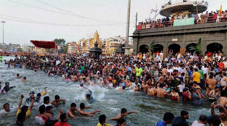 Devotees take holy dip at the Maha Kumbh in Nashik. (Source: PTI photo)