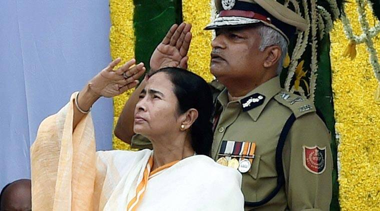 West Bengal Chief Minister Mamata Banerjee salutes to National flag after hoisting during Independence day celebration in Kolkata on Saturday. (Source: PTI Photo)