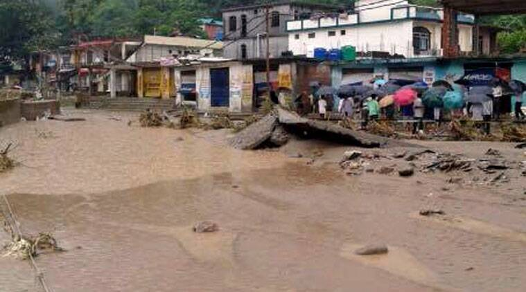 Flooded Dharampur market and bus station after a cloud burst in Mandi district on Saturday. (Express photo)