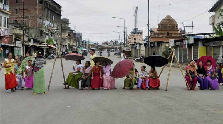 Women block a road at Konung Mamang in Imphal East district on Tuesday demanding for Inner Line Permit System in Manipur. (Source: PTI)