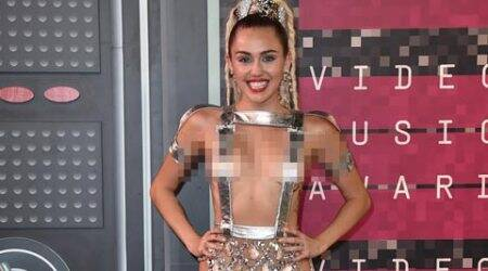 Miley Cyrus shakes in barely there silver straps at VMAs