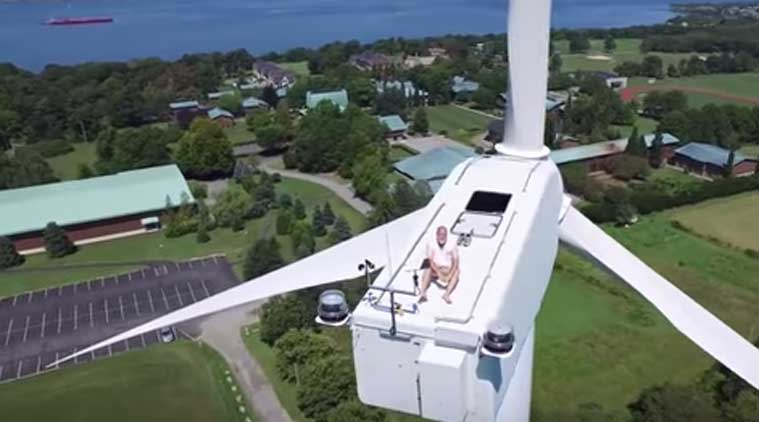Drone, Monk on Wind Turbine, Drone video, Drone captures monk on top of Windmill, Drone videos, Drones, Social media, Viral, Viral video