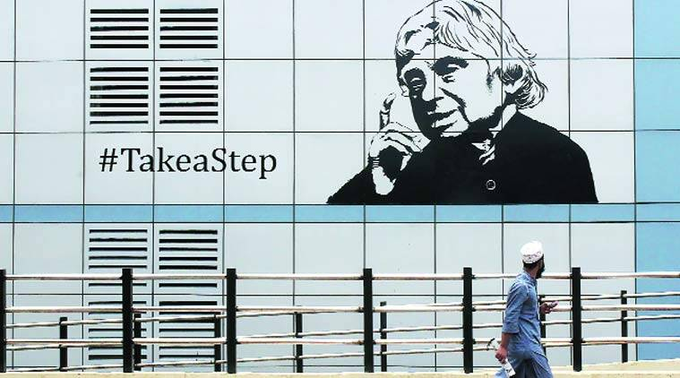 A man walks past a poster of former President, the late APJ Abdul Kalam, in Andheri. Amit Chakravarty