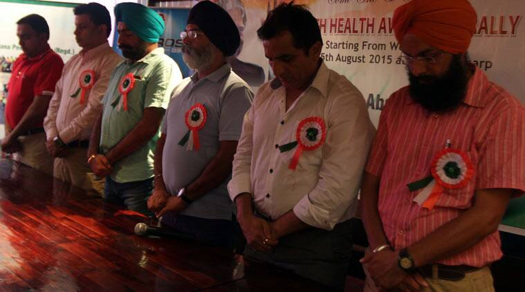 Members of the Ludhiana Pedallers Association observe 2 minutes silence during on the death of O.P. Munjal in Ludhiana. (Source: Express Photo by Gurmeet Singh)