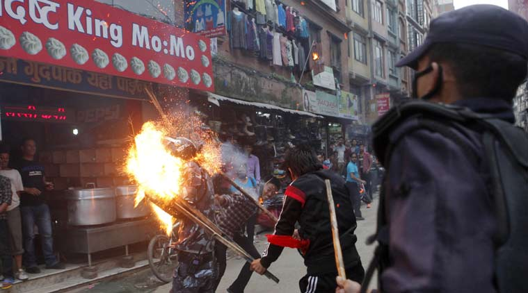 Nepalese protesters hit a policeman with a torch during a rally in Kathmandu, Nepal, Saturday, Aug. 15, 2015. Supporters of small opposition parties protested to oppose the constitution drafting process. (Source: AP photo/file)