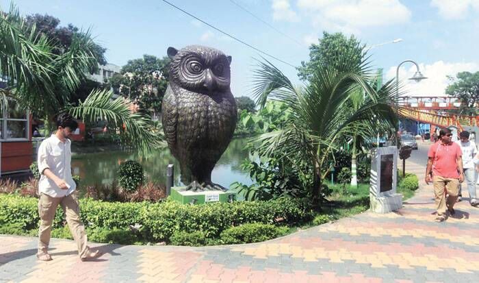 An owl sculpture at a park in Bangur