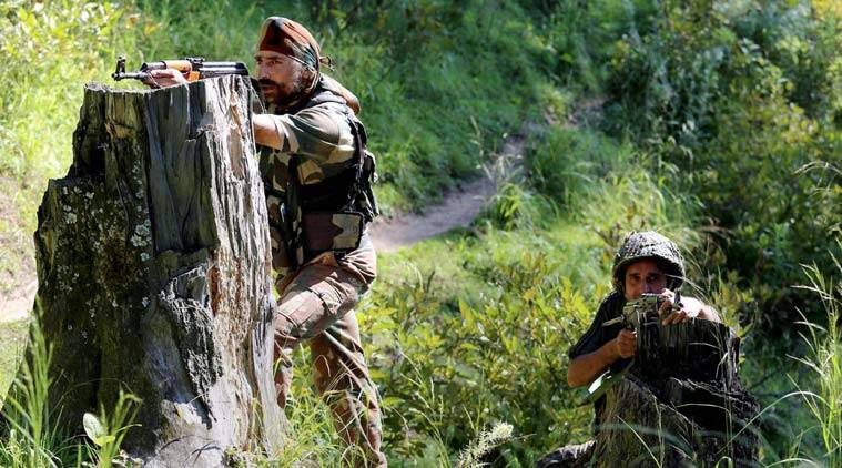 Baramulla : Special Operation Group (SOG) jawans take positions near the house where militants were hiding during an encounter at Rafiabad area of Baramulla district on Thursday. A Pakistani militant was captured alive in the encounter. PTI Photo