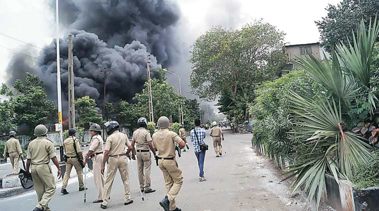 Patidar protesters set buses on fire at the depot in Udhna area of Surat city. (Source: Express Photo)