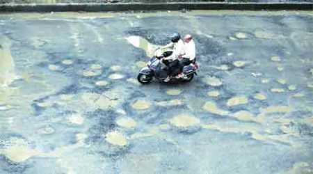 Mumbai man, whose son died in accident, fills potholes to save others