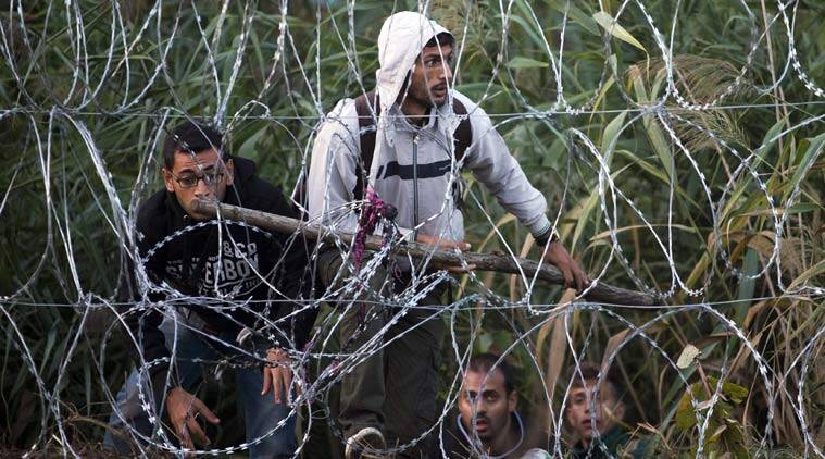 German Catholic church, Syrian refugee, refugee crisis, Church on refugees, Germany cant afford refugees, reduction in influx of refugees, germany syrian refugee, ISIS