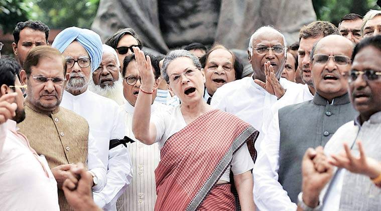 Sharad Yadav and K C  Tyagi of the JD(U) join an aggressive Sonia Gandhi and former PM Manmohan Singh outside Parliament on Wednesday, second day of their protest against the suspension of 25 MPs. (Source: PTI photo)