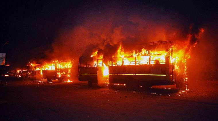 Buses set on fire in Surat on Tuesday night by people after the arrest of Hardik Patel, convener of 'Patidar Anamat Andolan Samiti. (Source: PTI)