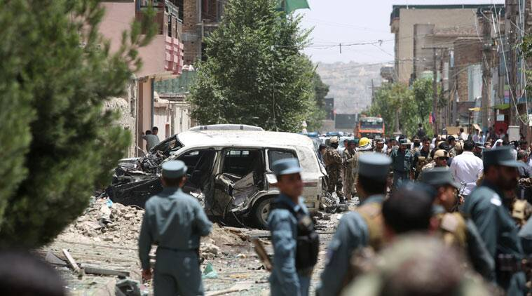In this Friday, Aug. 7, 2015, photo, Afghan security personal inspect at the site of a suicide car bomber has targeted a NATO convoy in Kabul, Afghanistan. While leaders of the Afghan Taliban meet to resolve the leadership turmoil that has engulfed the group since their one-eyed leader Mullah Mohammad Omar was revealed to be dead, Afghanistan's relationship with Pakistan is deteriorating at a dangerous juncture in the war, with the neighboring countries trading blame for stoking tensions and President Ashraf Ghani accusing Islamabad of sponsoring the insurgency now nearing its 14th year with almost 5,000 civilian deaths so far this year. (AP Photo/Rahmat Gul)