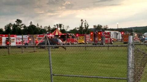 Officers surround the scene of a tent collapse in Lancaster, N.H., Monday, Aug. 3, 2015. Authorities say the circus tent collapsed when a severe storm raked the New Hampshire fairground. (Sebastian Fuentes via AP)