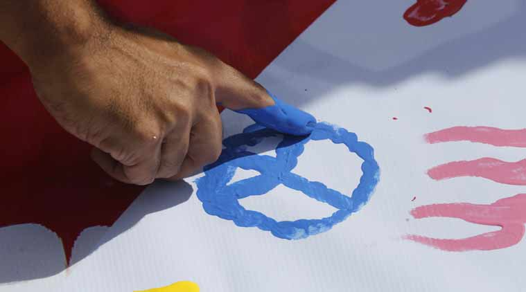 People leave finger painted messages for bombing victims at a plaza across from the Erawan Shrine at Rajprasong intersection. AP Photo