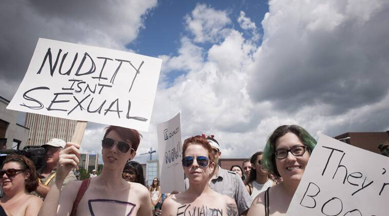 """""""Bare With Us"""" demonstrators gather at the Waterloo Town Square in Waterloo, Ontario, Canada, on Saturday, Aug. 1, 2015.  (Source: AP)"""