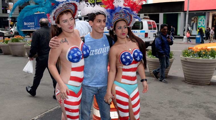 Topless women, Times Square, Painted women, Topless painted women, Andrew Cuomo, New York governor, Topless women illegal acts, Painted women, world news