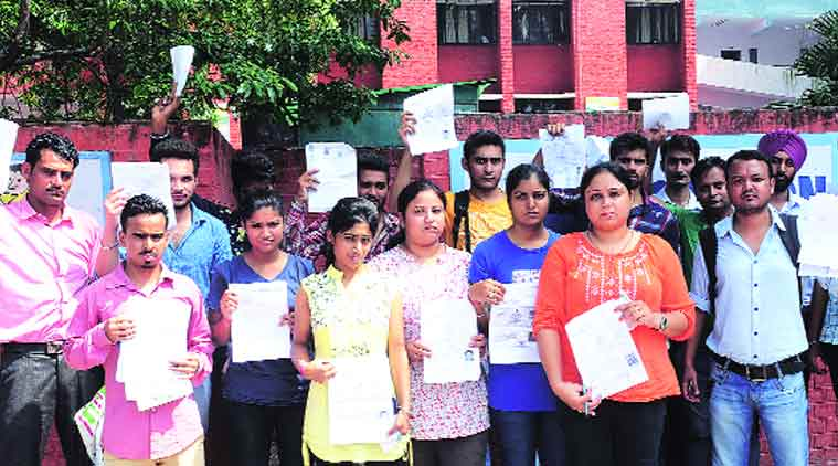 The SSC aspirants who were not allowed to sit for the exam, at Government Model High School in Sector 37, Chandigarh, on Sunday.(Express Photo by: Sahil Walia)