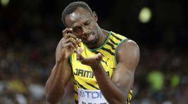 Usain Bolt Beats Justin Gatlin But Gets Knocked Over ByCameraman