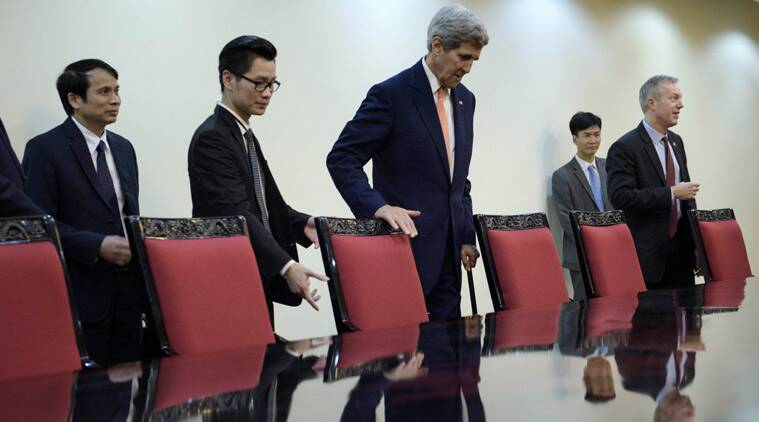 U.S. Secretary of State John Kerry, center, takes his seat for a meeting with Deputy Prime Minister Vu Duc Dam Friday, Aug. 7, 2015, in Hanoi, Vietnam. (Brendan Smialowski/Pool via AP)