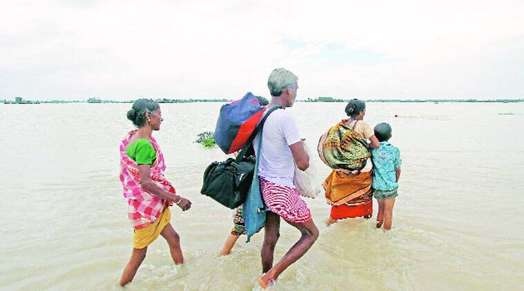 Villagers wade through Mirati village in Birbhum district of West Bengal on Sunday.(Source: PTI photo)