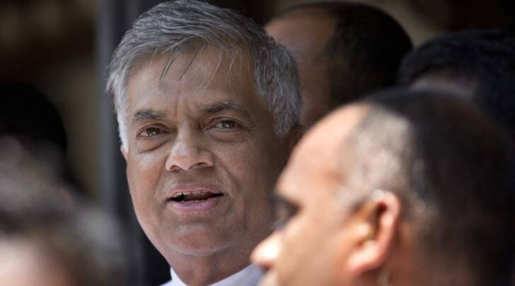 Sri Lankan Prime Minister Ranil Wickremasinghe, left, outside a polling station after casting his vote during Parliamentary elections in Colombo, Sri Lanka (AP photo)