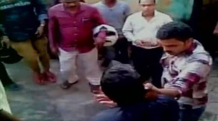 Youth allegedly being beaten by Hindu right wing group in Mangalore. (Source: ANI)