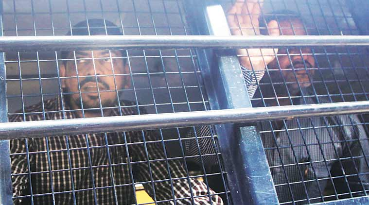 The convicts being taken to the court Tuesday. (Express hoto by Ganesh Shirsekar)