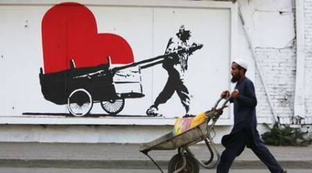 Afghan artist group uses evocative street art to highlight social problems