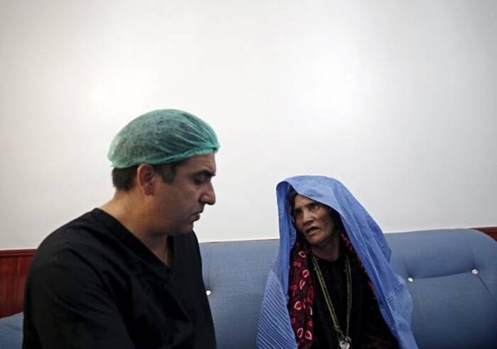 Plastic surgeon Abdul Ghafar Ghayur (L) speaks to a patient at Aria City Hospital in Kabul, Afghanistan (Source: Reuters)