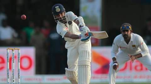 India's Ajinkya Rahane, left, plays a shot as Lahiru Thirimanne watches during the third day's play of the second test cricket match between them in Colombo, Sri Lanka, Saturday, Aug. 22, 2015. (AP Photo/Eranga Jayawardena)