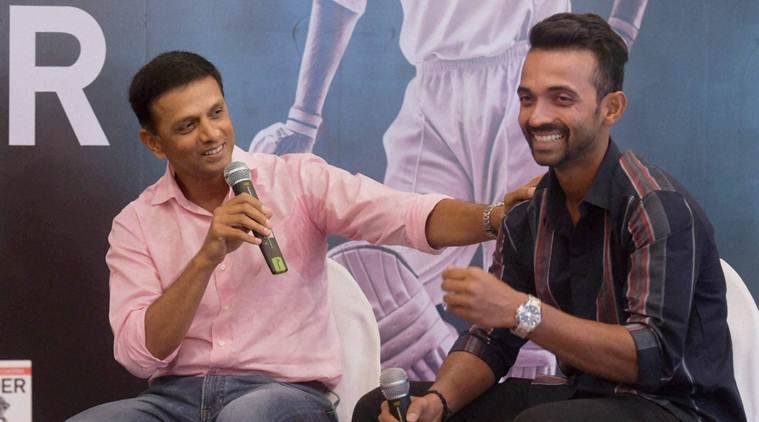 "Mumbai: Former captain Rahul Dravid with Ajinkya Rahane during the launch of former cricketer Akash Chopra's book ""The Insider"", in Mumbai on Friday. PTI Photo by Santosh Hirlekar  (PTI9_4_2015_000268B)"