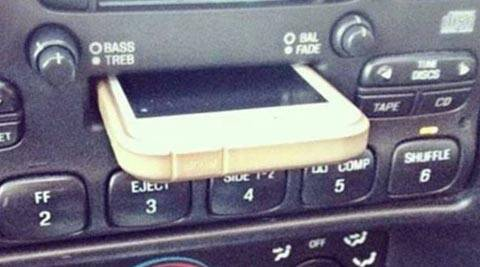 Viral photo, iPhone, iPhone 5 in cassette player, guy puts iPhone in cassette player, Car cassette player, iPhone viral story, Viral