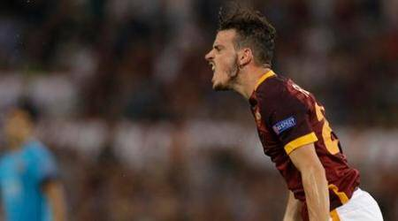 Roma's Alessandro Florenzi reacts after missing a scoring chance during the Champions League Group E soccer match between Roma and Barcelona in Rome's Olympic stadium, Italy, Wednesday, Sept. 16, 2015. (AP Photo/Gregorio Borgia)