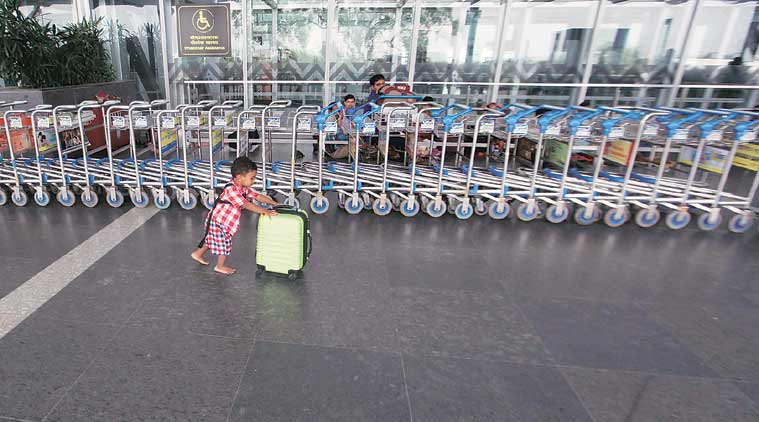 A child plays at the deserted Kolkata airport on Wednesday. The family had come to the airport on Tuesday night to catch a flight. (Source: Express photo by Subham Dutta)