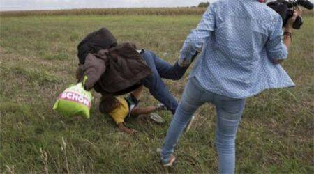 migrant, hungary, hungary migrant, migrant tripped, migrant kicked, tv crew trip migrant, tv crew kick migrant, tv camerawoman trip migrant, tv camerawoman kick migrant, migrant crisis, migrant news, europe migrant, eu migrant, europe migrant crisis, hungary news, world news, latest news